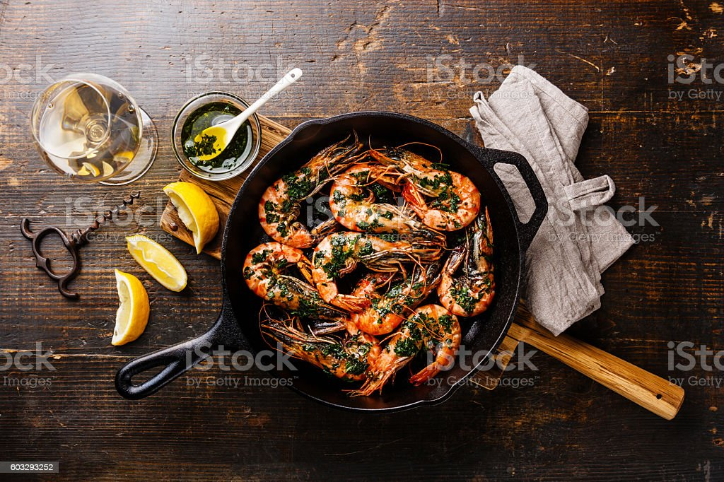 Tiger prawns roasted on frying pan and wine stock photo