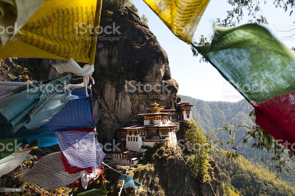 Tiger's nest between prayer flags royalty-free stock photo