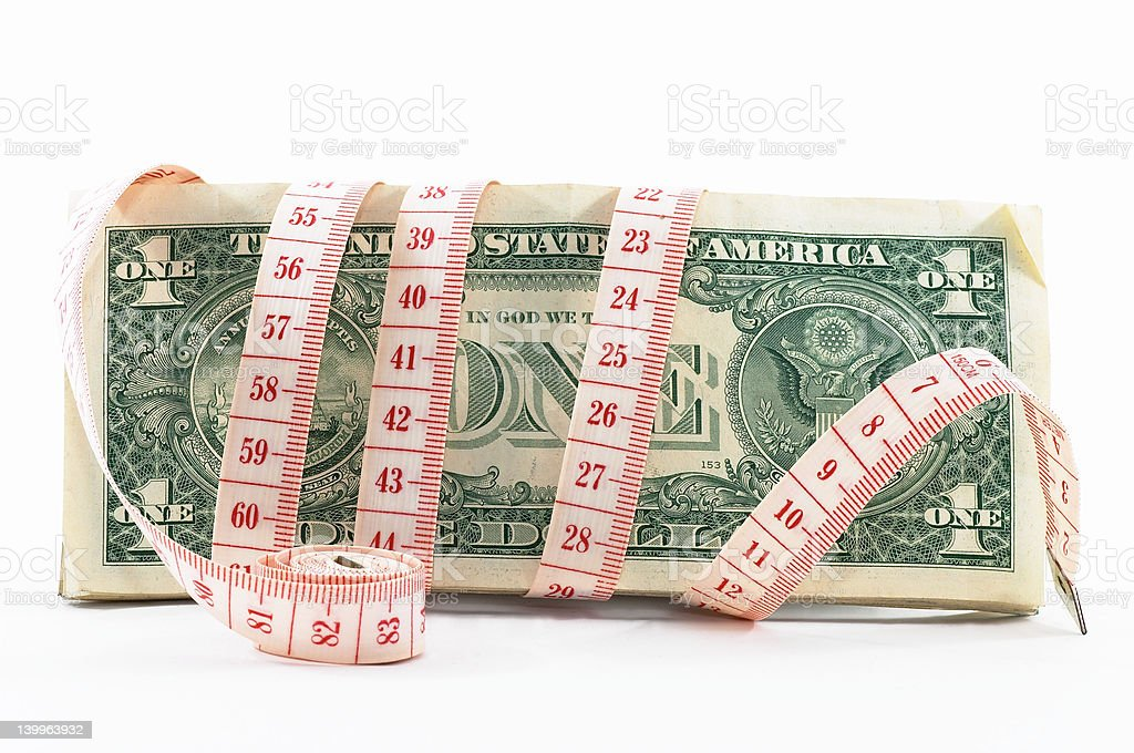 Tight budgeting. Rolled tape on its side. royalty-free stock photo
