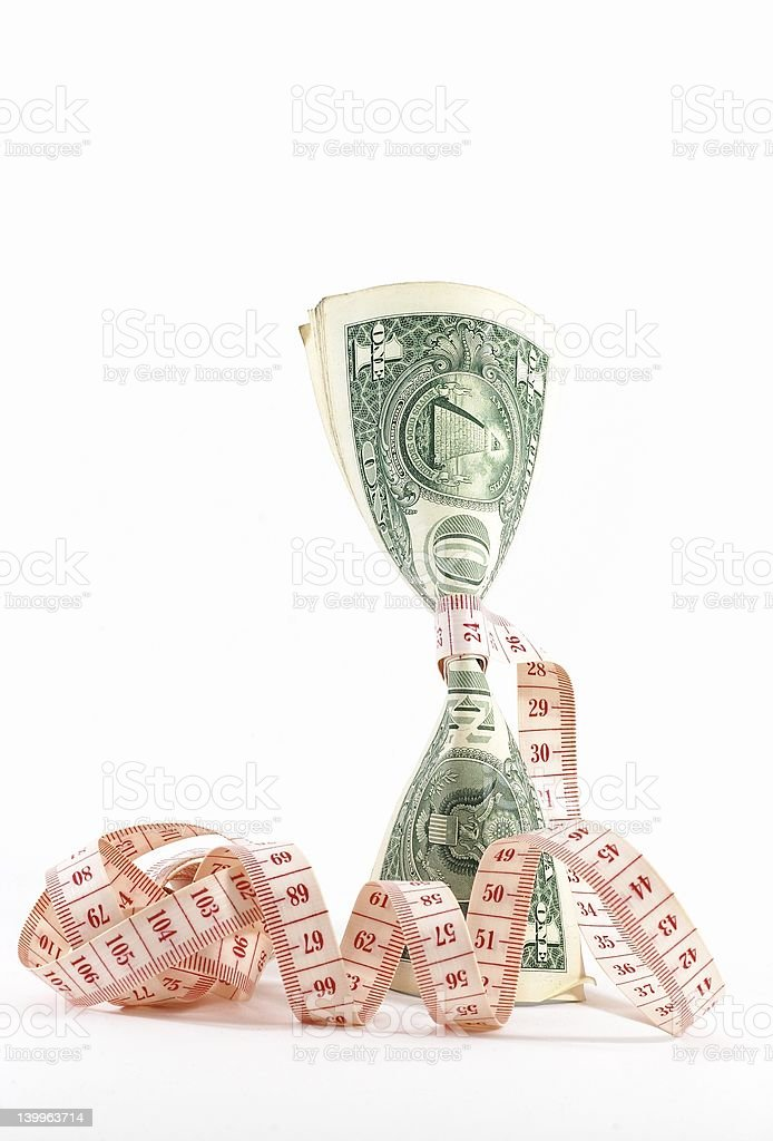 Tight budgeting. Upright money. stock photo