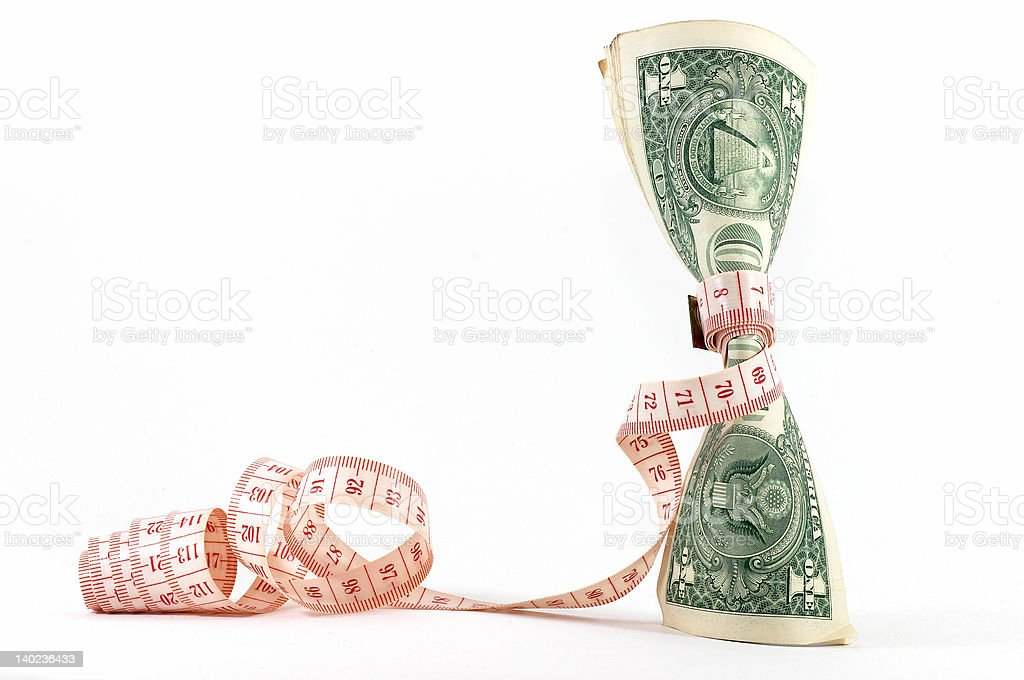 Tight budgeting. Upright money. royalty-free stock photo