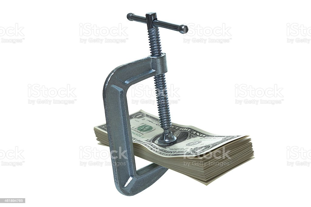 Tight clamp on stack of dollar bills stock photo