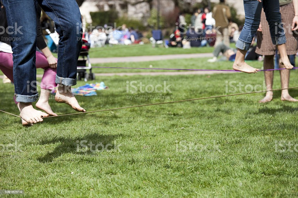 Tight rope walking in the park royalty-free stock photo