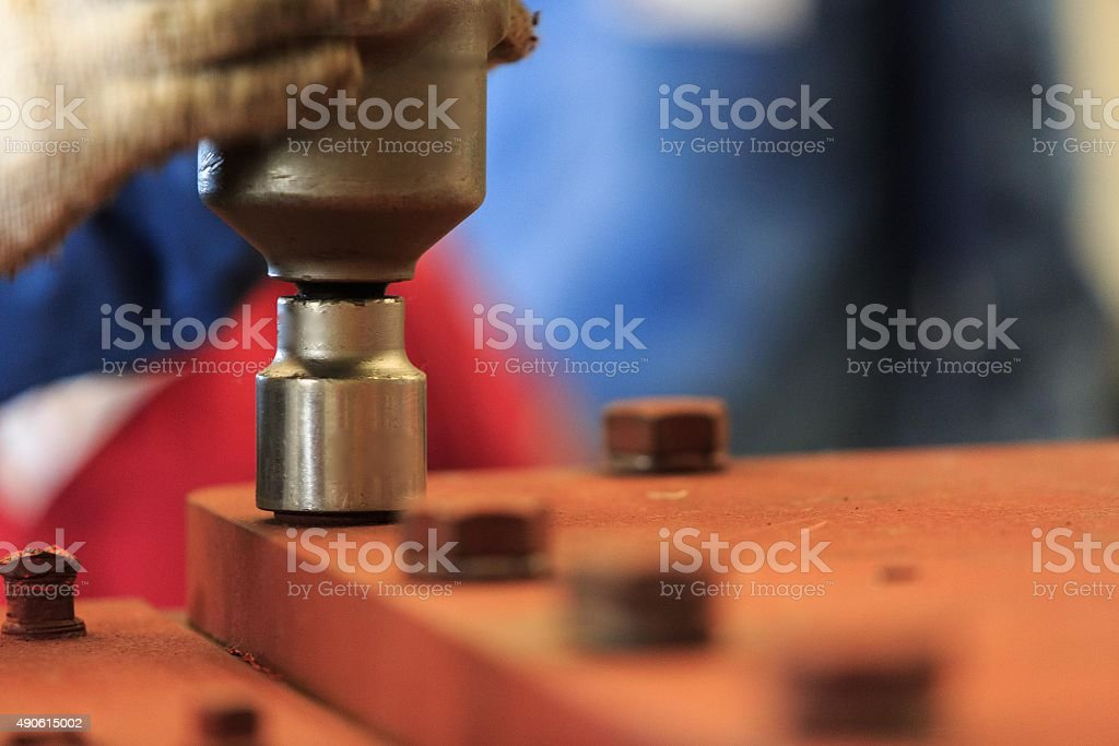 Tighten bolt with pneumatic torque wrench stock photo
