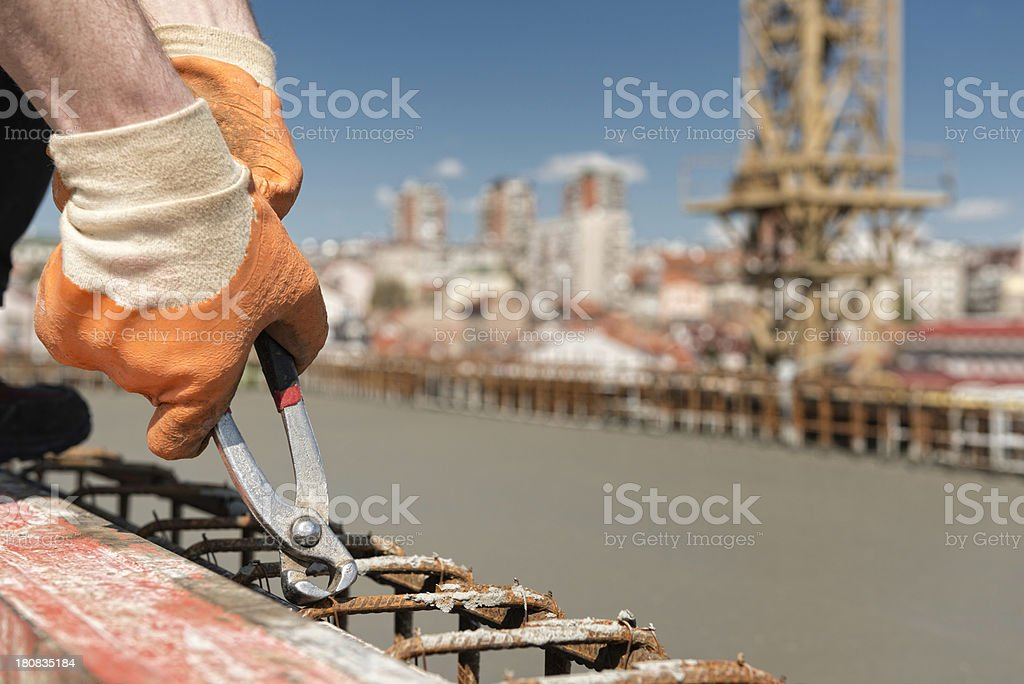Tightening concrete armature wire mesh royalty-free stock photo