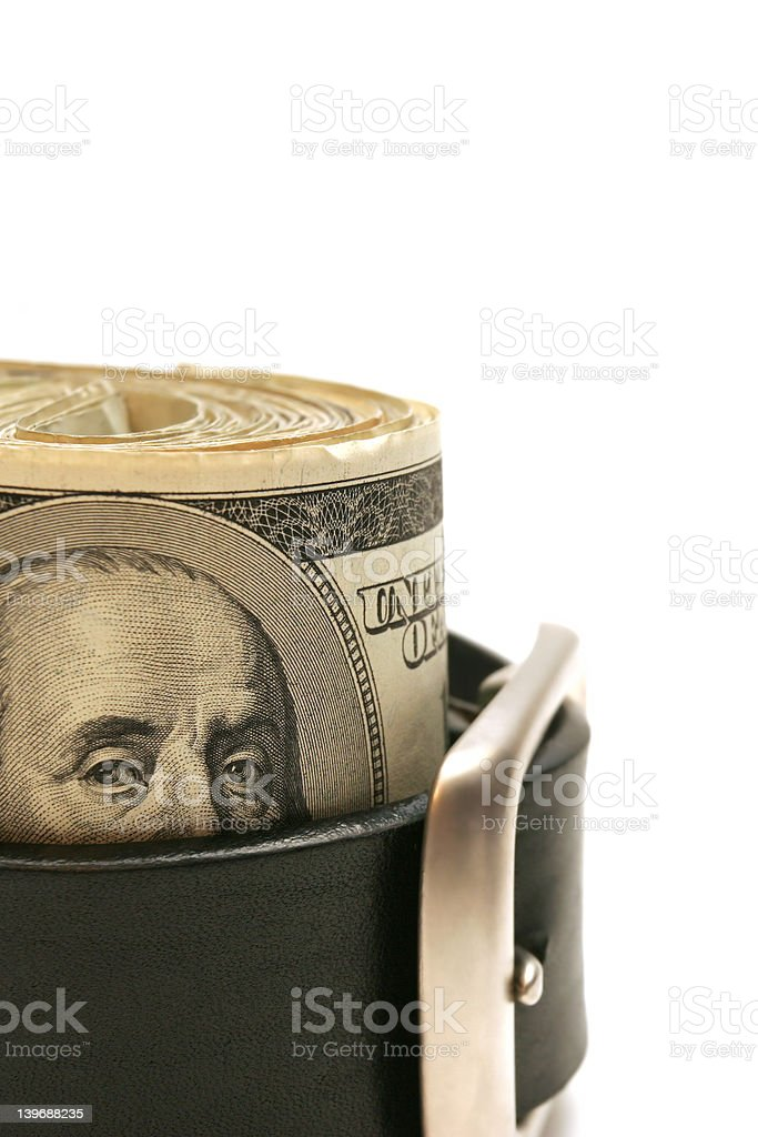 tightening the belt royalty-free stock photo