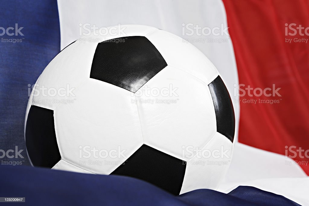 Tightly cropped close up of soccer ball on French flag stock photo