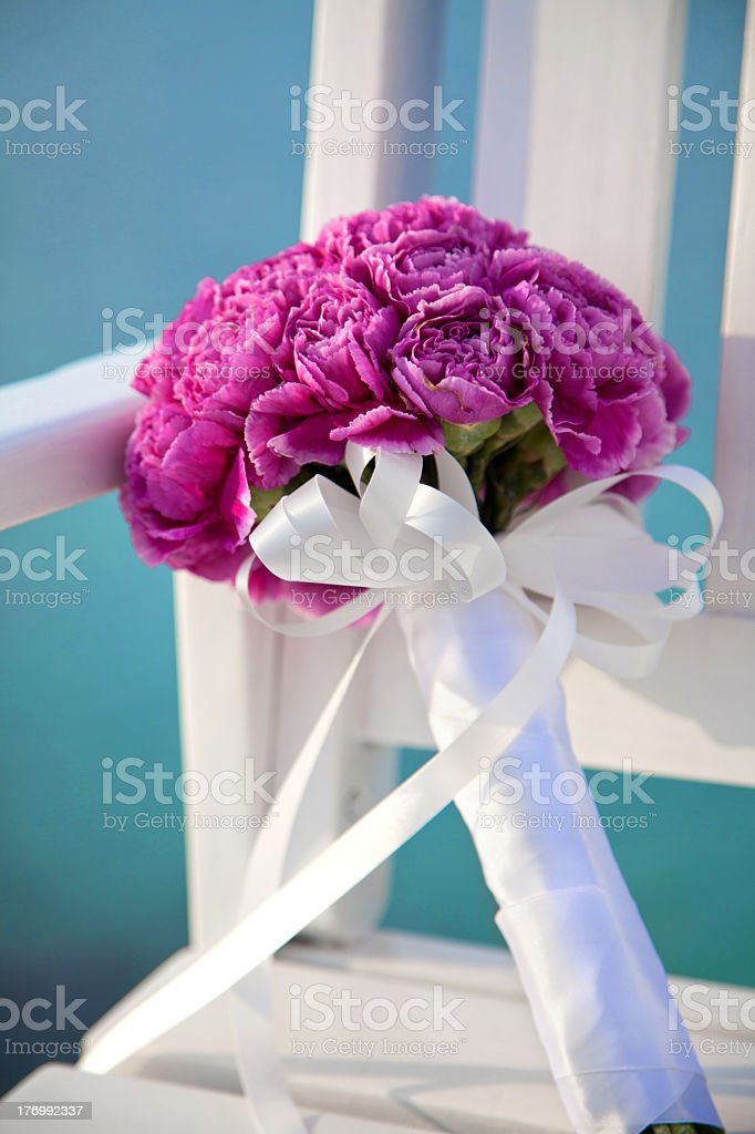 Tightly wrapped bright purple flower bridals bouquet royalty-free stock photo
