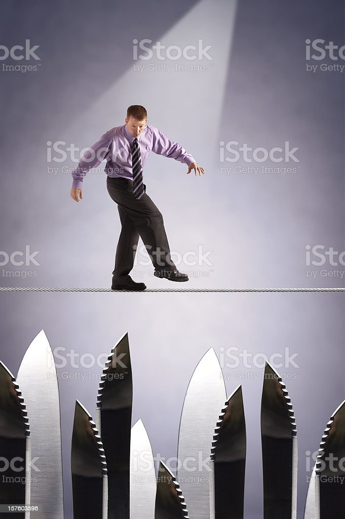 Tightrope over risk and danger royalty-free stock photo