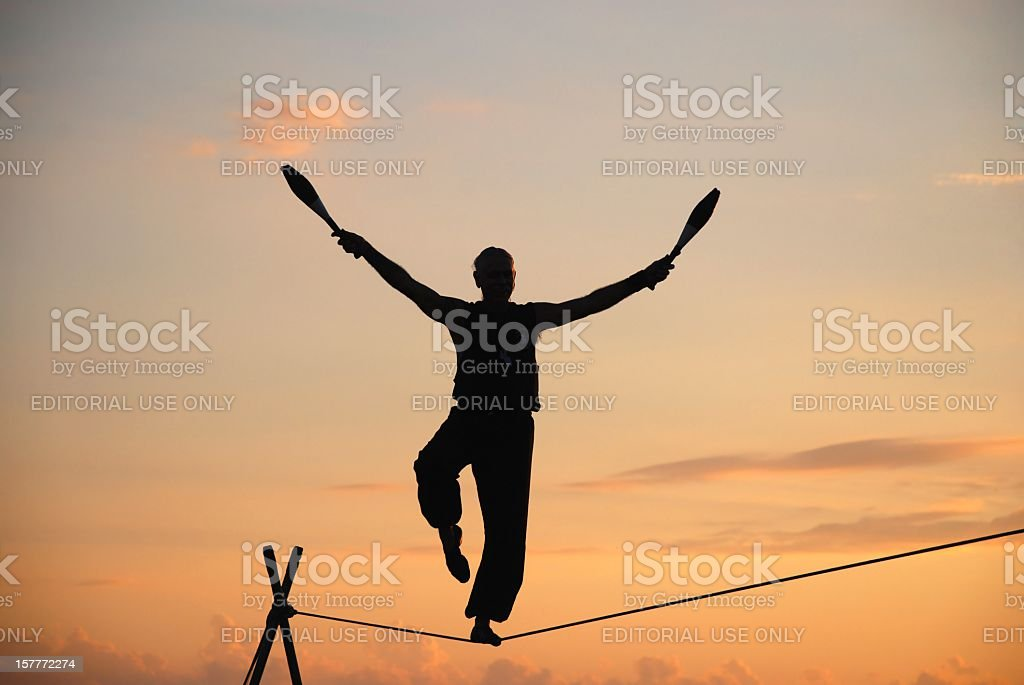 Tightrope Walker at sunset stock photo