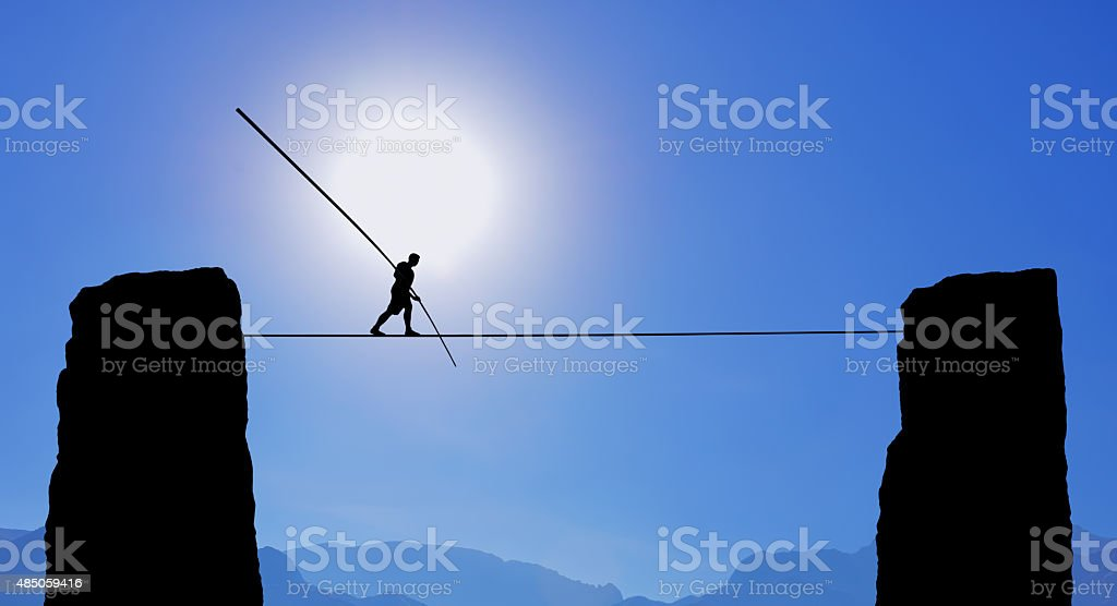 Tightrope Walker Balancing on the Rope stock photo