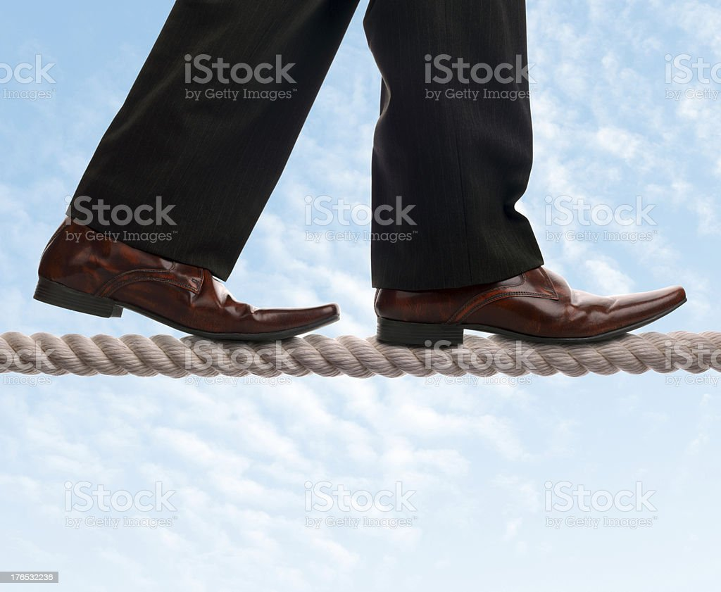 Tightrope walker businessman stock photo