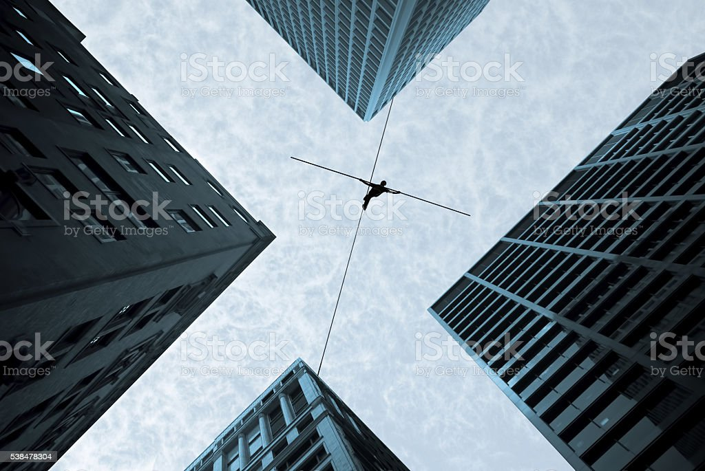 Tightrope walker concept of risk taking and challenge stock photo