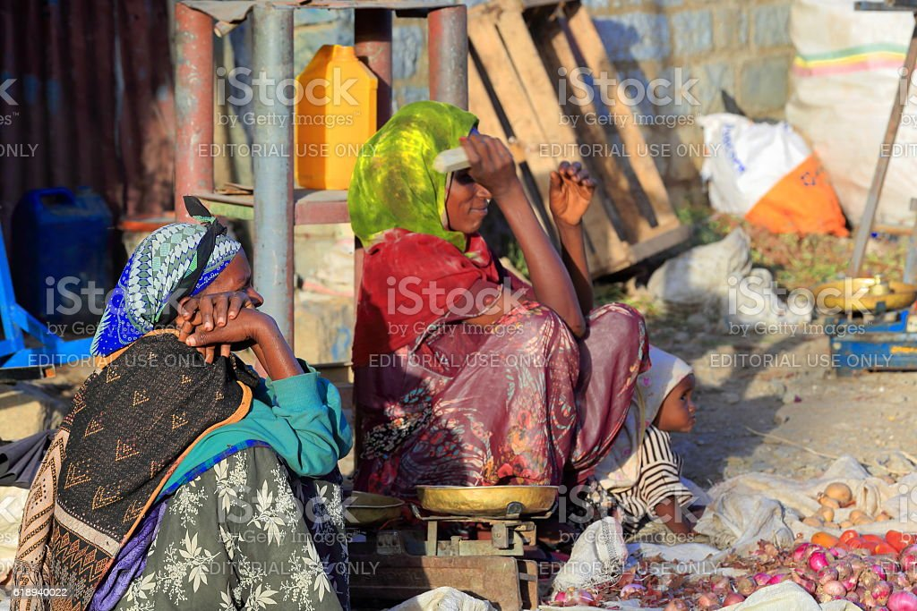 Tigrayan women sell vegetables on the sidewalk. Mekelle-Ethiopia. 0483 stock photo