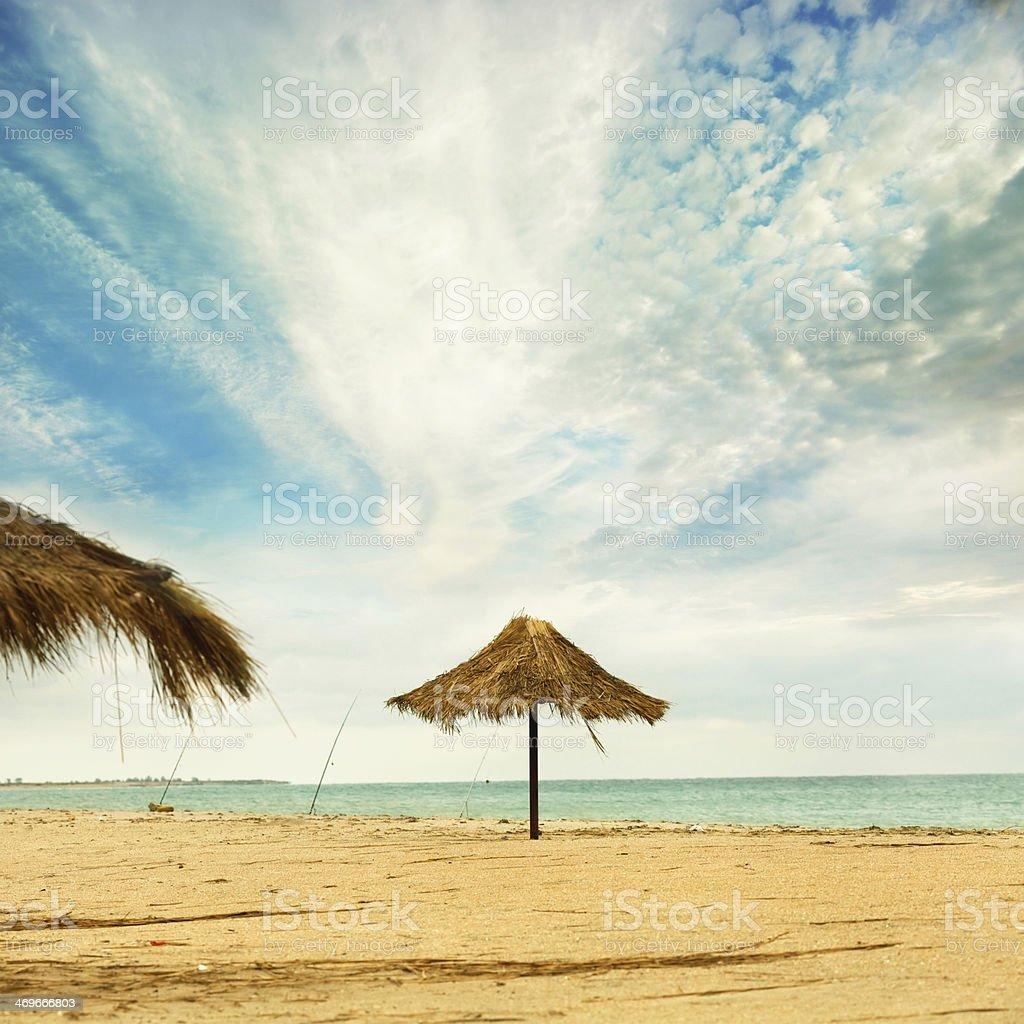Tiki hut on the beach stock photo