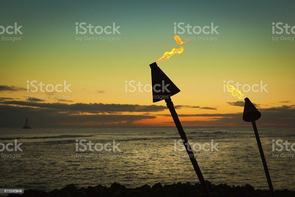 Tiki Lamp in Tropical Paradise Beach Sunset Hz stock photo