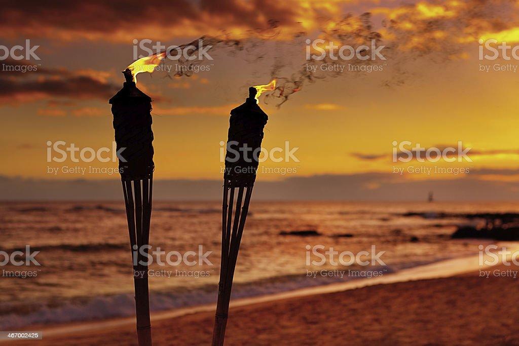 Tiki Lamps on the Beach of Hawaii stock photo