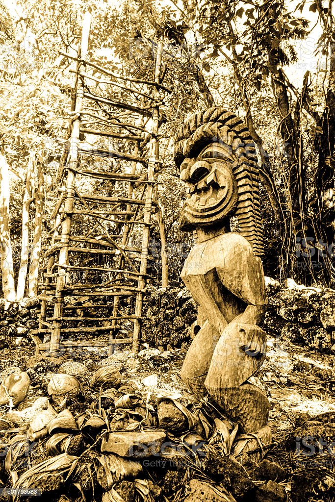 Tiki statue at Kane'aki Heiau in Makaha stock photo