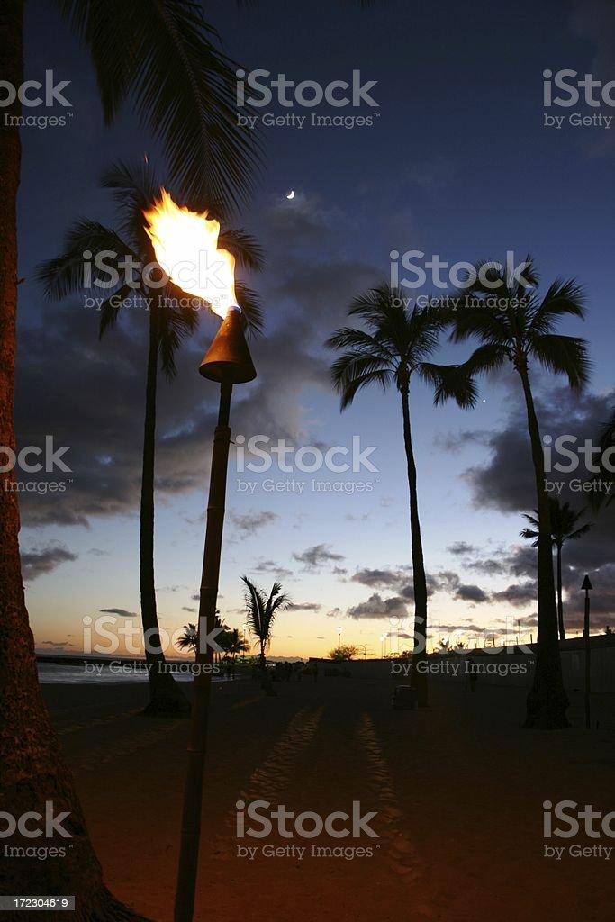 Tiki Sunset with Palm Trees Waikiki Honolulu stock photo