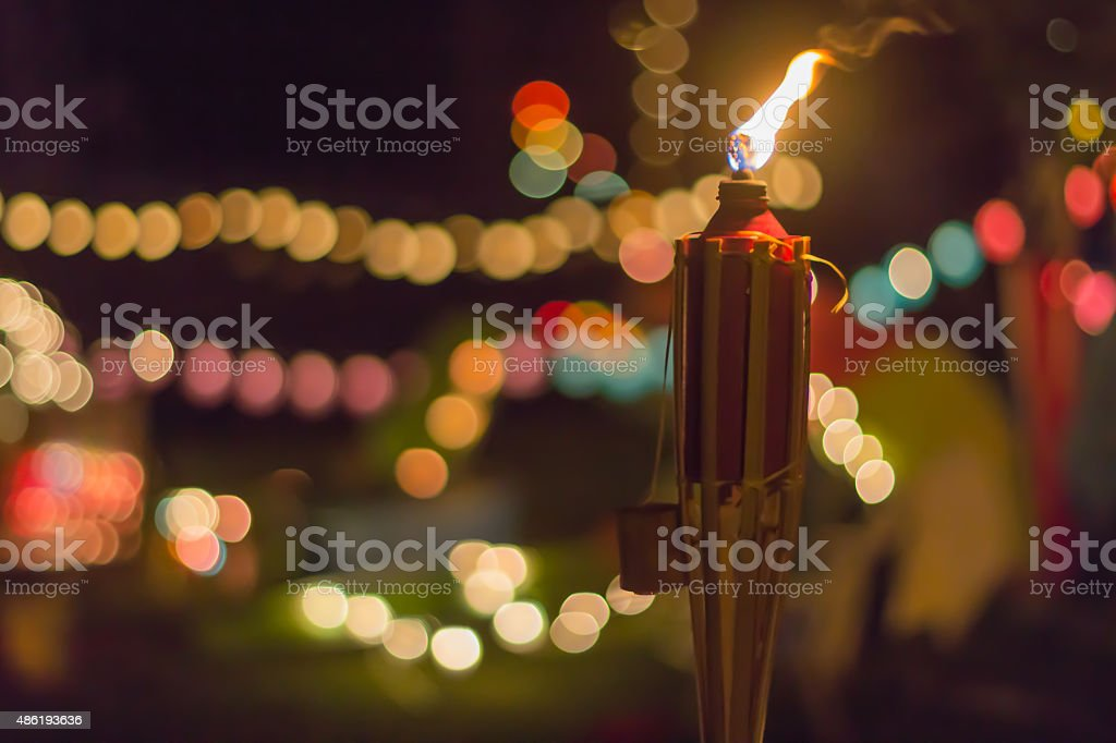 Tiki Torch at Night with lots of Bokeh stock photo