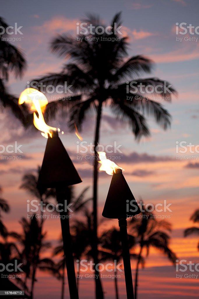Tiki Torch Flames At Sunset stock photo
