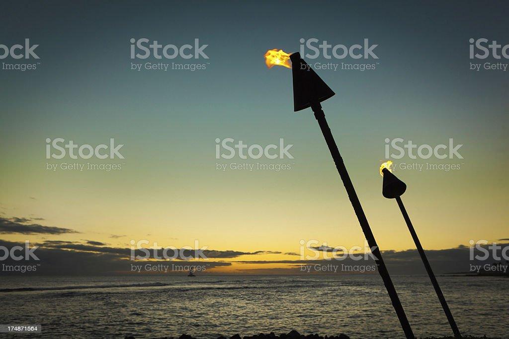 Tiki Torch Lamp in Tropical Sunset Horizontal stock photo