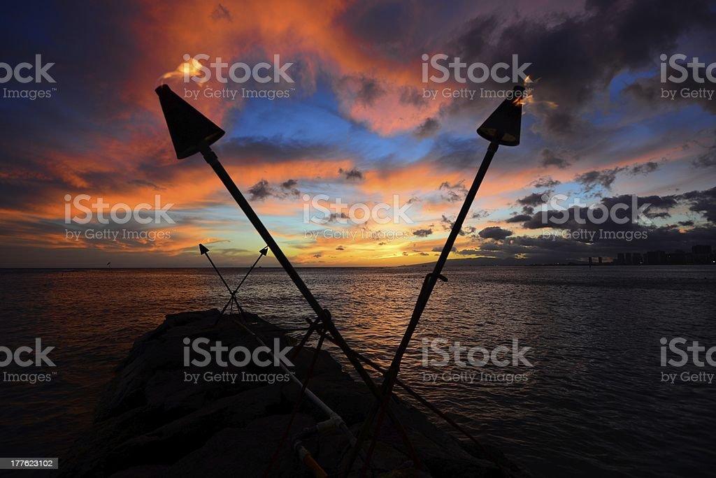 Tiki torch sunset stock photo