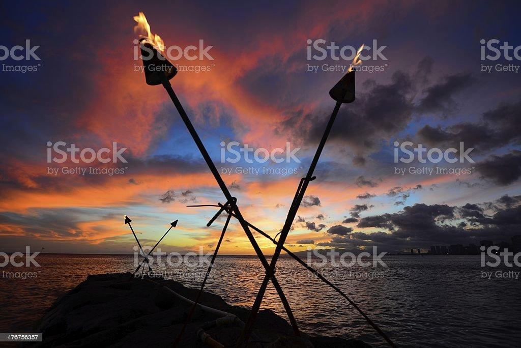 Tiki torch susnet stock photo
