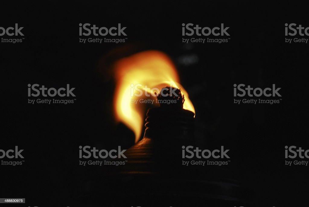 Tiki Torch with Black Background stock photo
