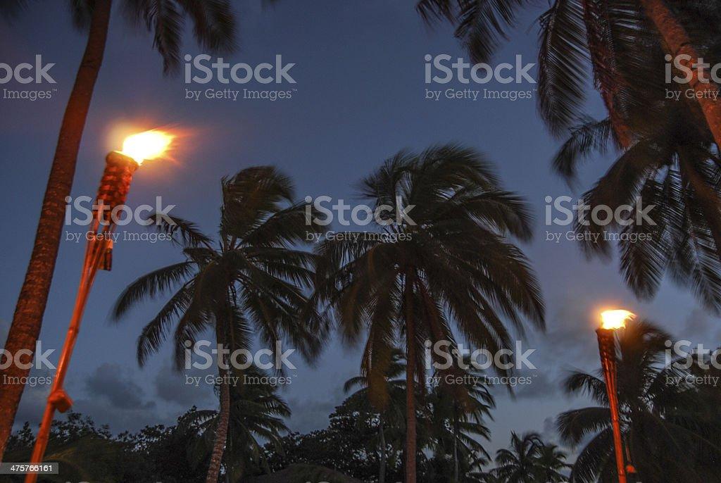 Tiki Torches and Twilight stock photo