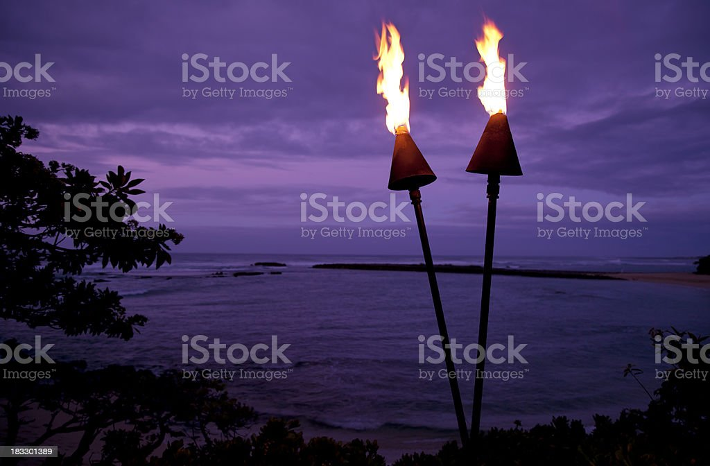 Tiki Torches in Hawaii at Sunset stock photo