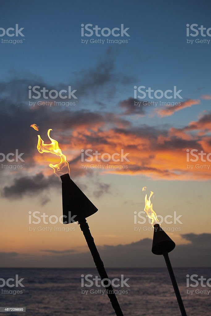 Tiki Tourch Lamp at Sunset in Hawaii USA stock photo