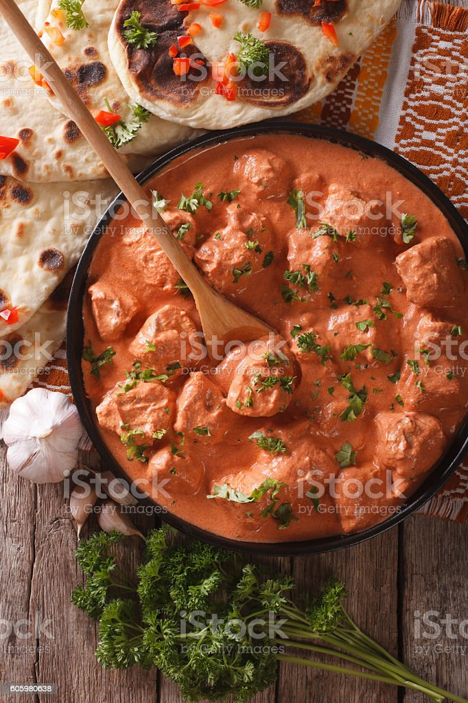 tikka masala chicken and naan flat bread close-up. vertical stock photo