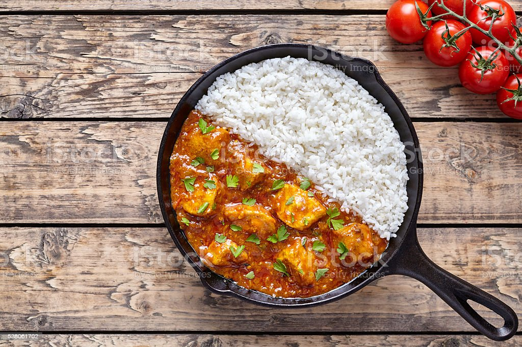 Tikka masala traditional butter chicken spicy meat food and rice stock photo