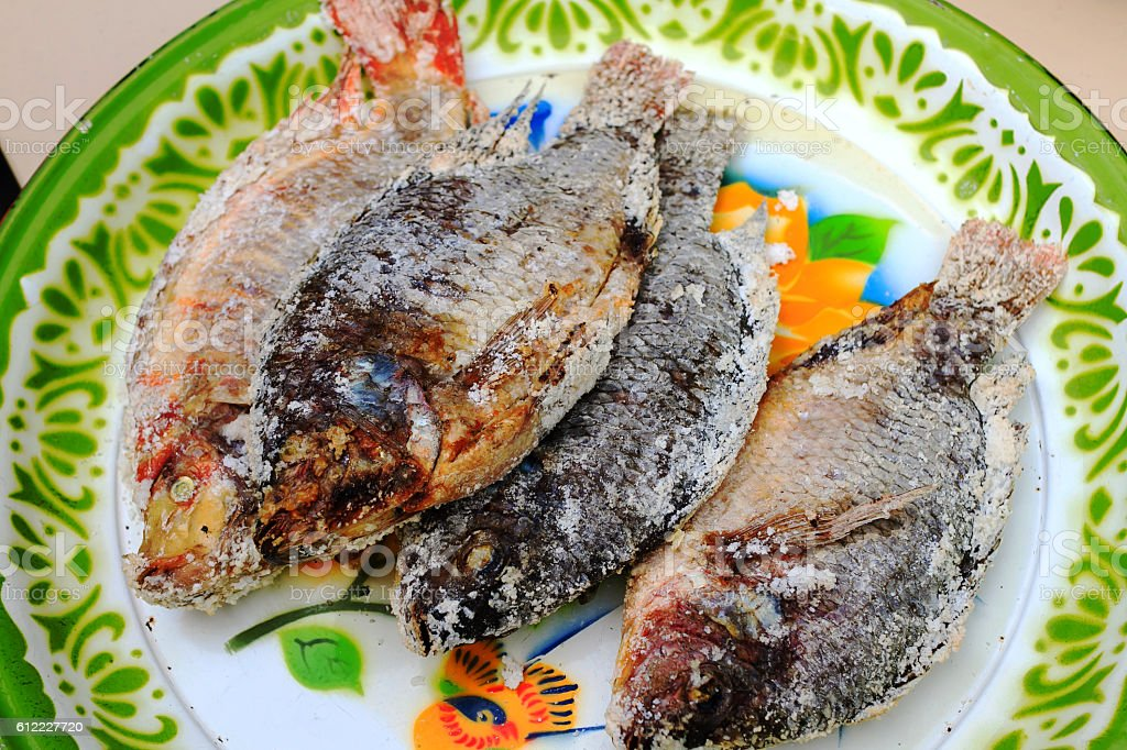 Tilapia baked salt stock photo