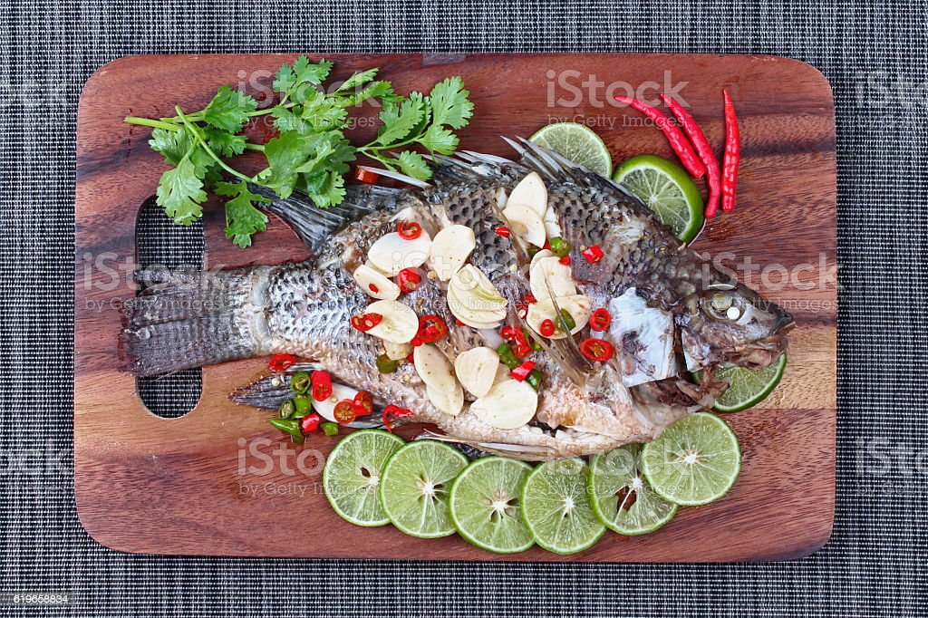Tilapia fish streamed with lemon ( Pla Nil Nuang Manoaw) stock photo