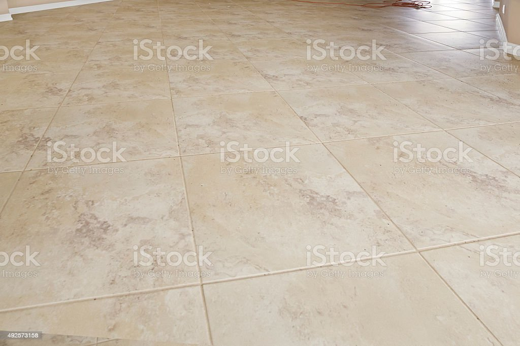 Tile flooring in empty home that is being renovated stock photo