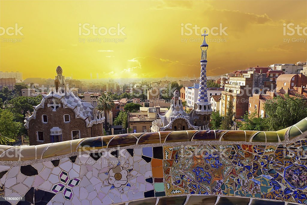 A tile mosaic in Park Guell in the foreground of Barcelona royalty-free stock photo