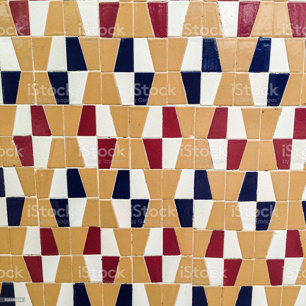 Tile of red, black, white and beige patterns. stock photo