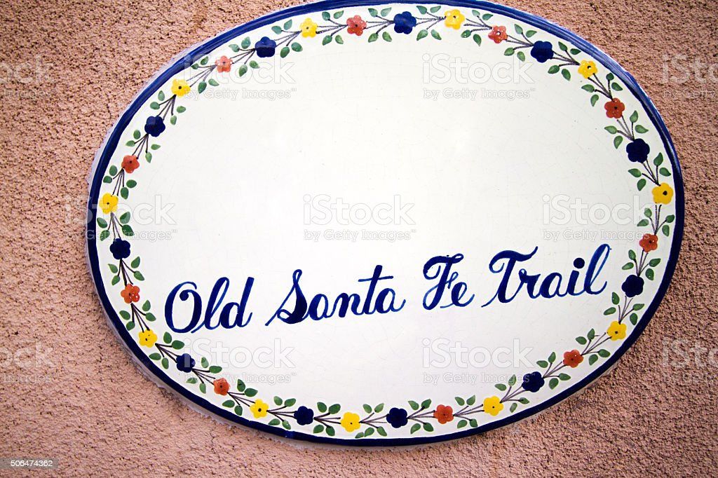 Tile 'Old Santa Fe Trail' Sign on Adobe Wall stock photo