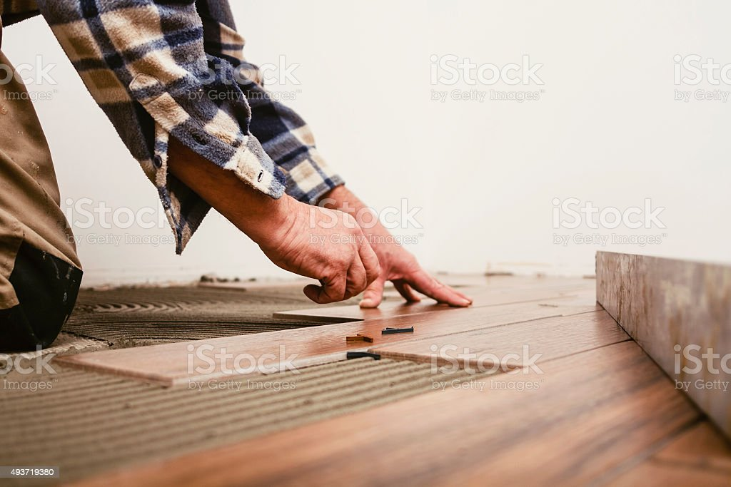 Tile placing stock photo