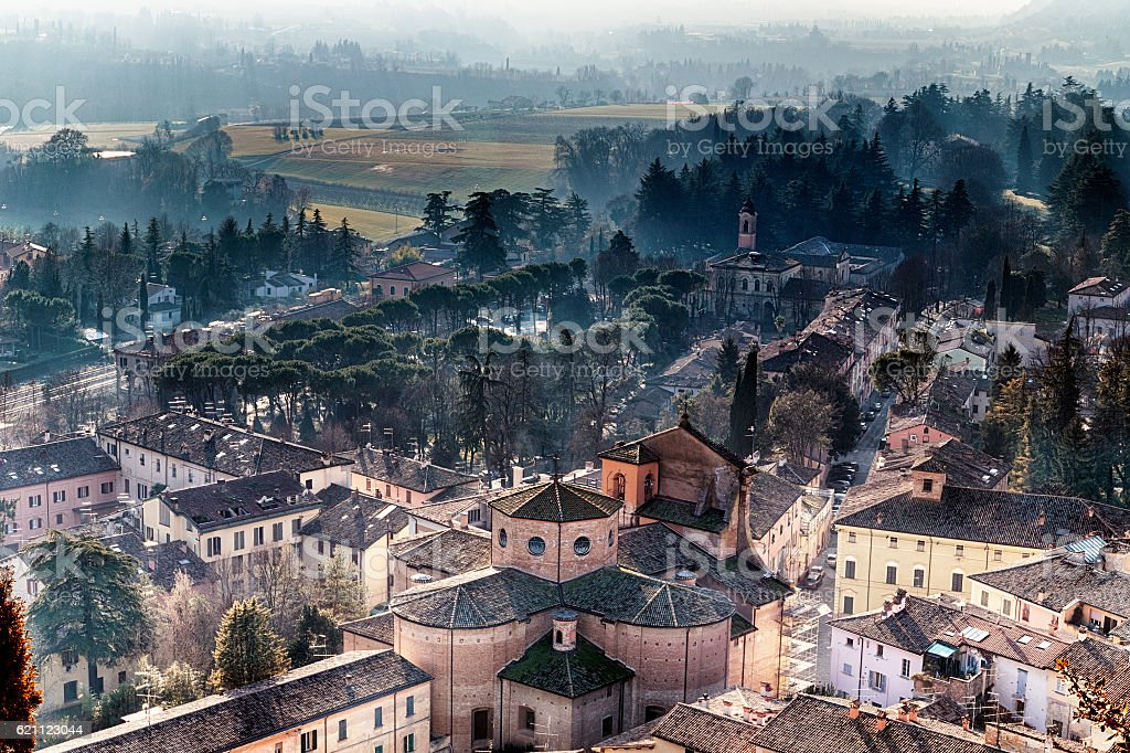 Tile roofs of Italian country village in the mist stock photo