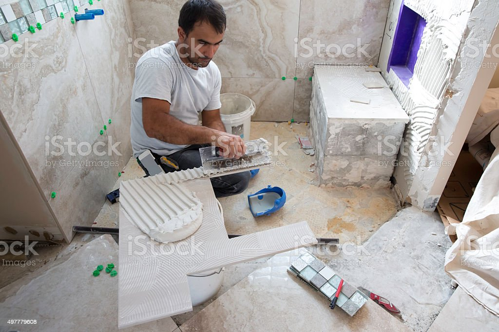 Tile series: Beautiful tile being installed in shower of home stock photo