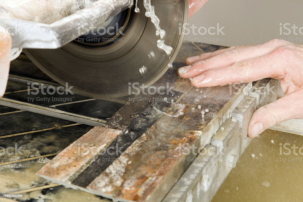 Tile Setter Cutting Stacked Stones with a Wet Saw stock photo