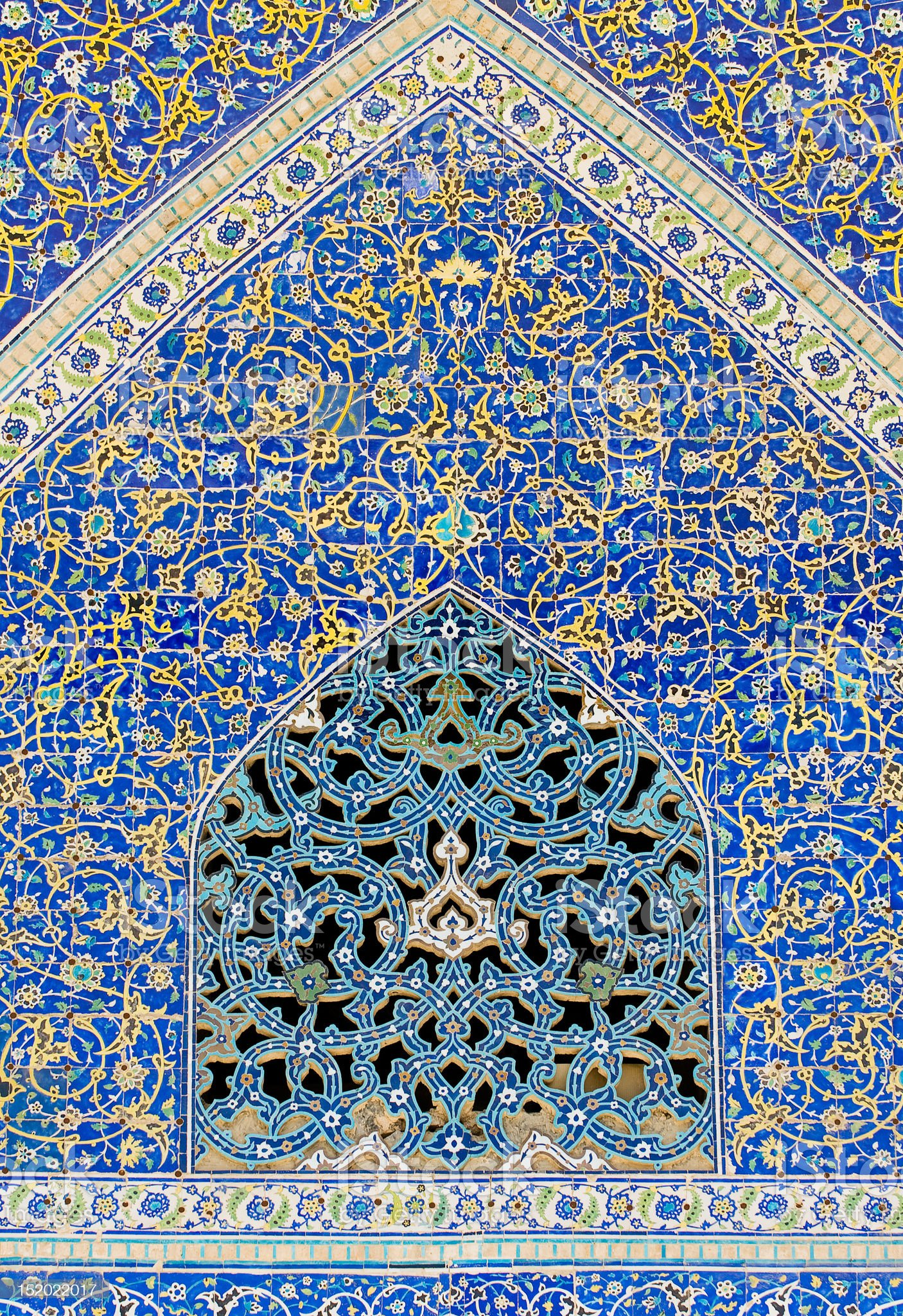 tiled background, oriental ornaments from Isfahan Mosque, Iran royalty-free stock photo