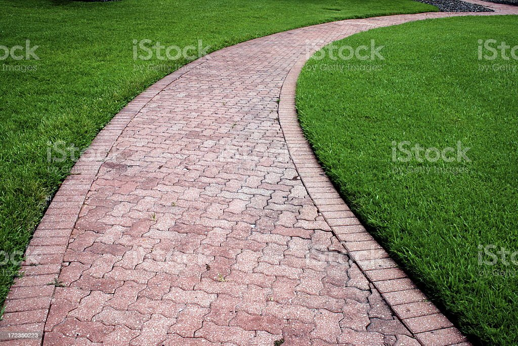 tiled curved footpath royalty-free stock photo