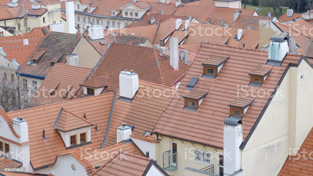 tiled red rooftops Prague stock photo