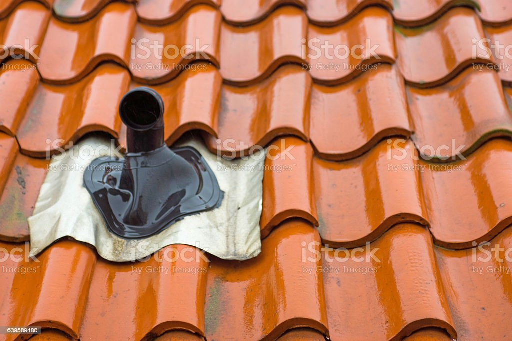 Tiled roof with chimney stock photo