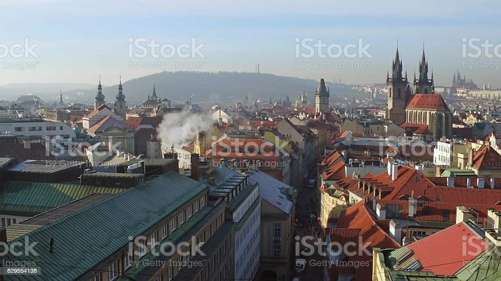 Tiled roofs and gothic spires of Old town in Prague stock photo