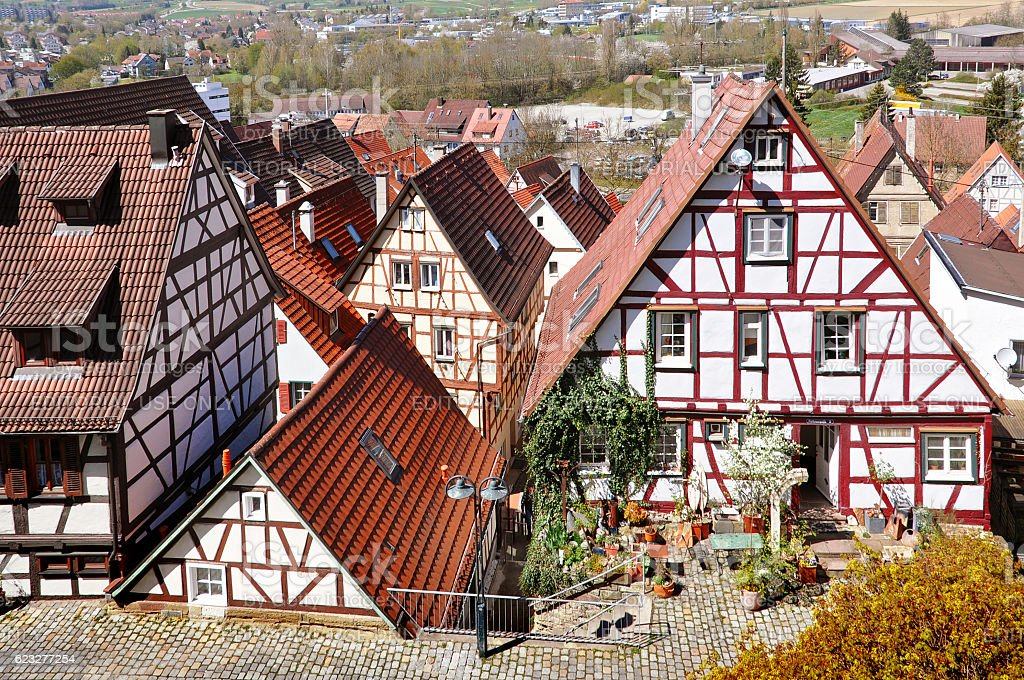 Tiled roofs of half-timbered houses of old city. stock photo